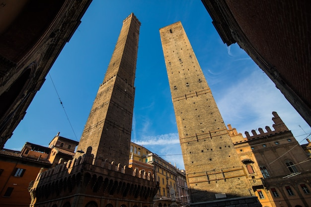 Two famous falling towers asinelli and garisenda in the morning, bologna, emilia-romagna, italy