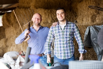 Two farm workers in hayloft