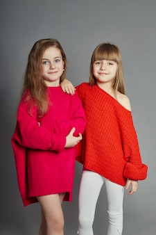 Two fashion girls kid in red jackets