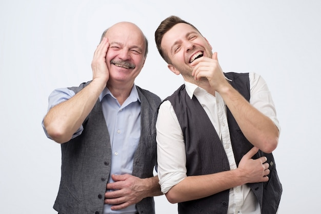 Two father and son men laughing