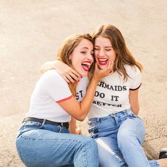 Two female friends making fun