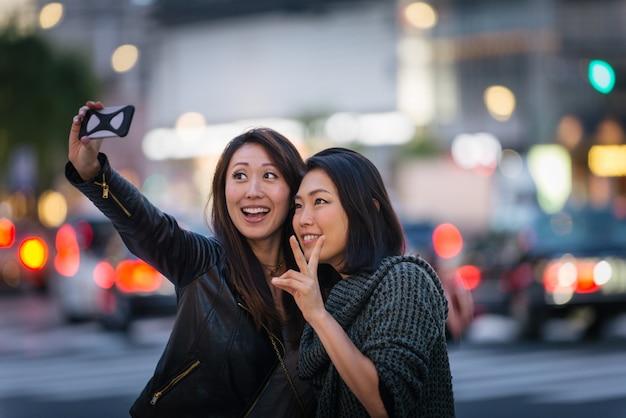 Two female friends meeting in tokyo