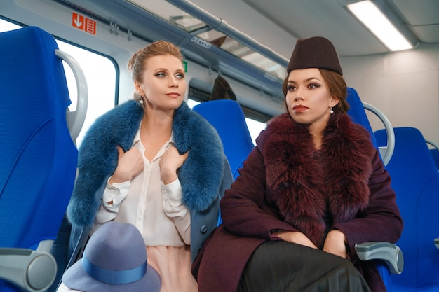 Two female friends on the train