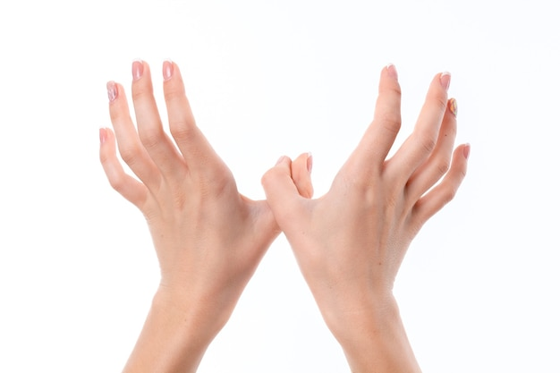 Two female hands outstretched forward with raised upward and backward palms closeup