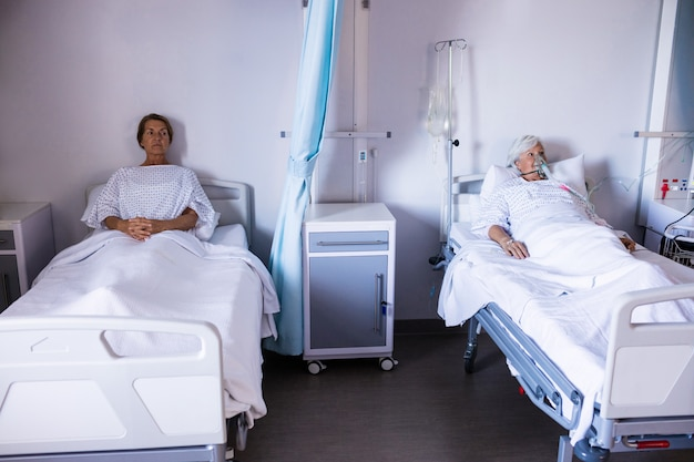 Two female patient relaxing in the ward