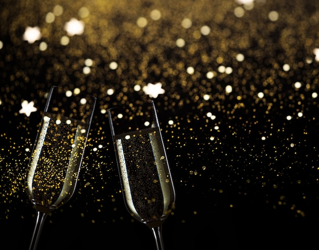 Two festive champagne glasses on black background with golden bokeh lights and sparkles