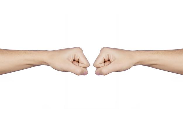 挨拶で向かい合う2つの拳、ぶつかる拳