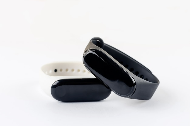 Two fitness tracker stays on the white background.