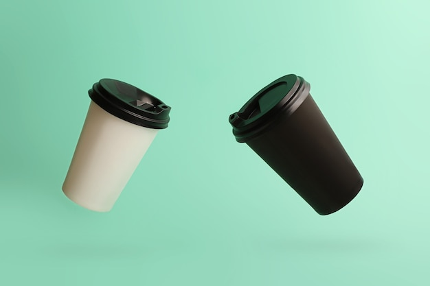 Two flying cups of coffee on the beautiful mint backgroundblack and white  dual colors