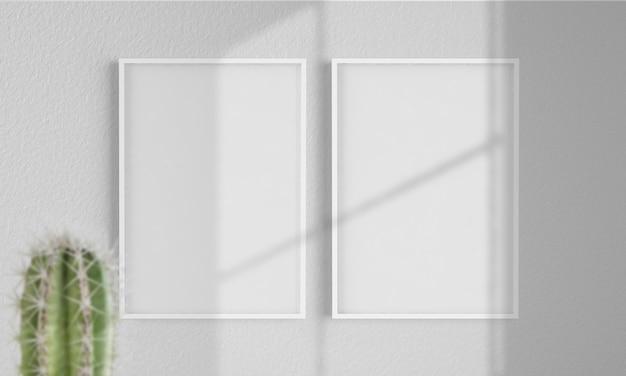 Две рамки на стене макет 3d рендеринга