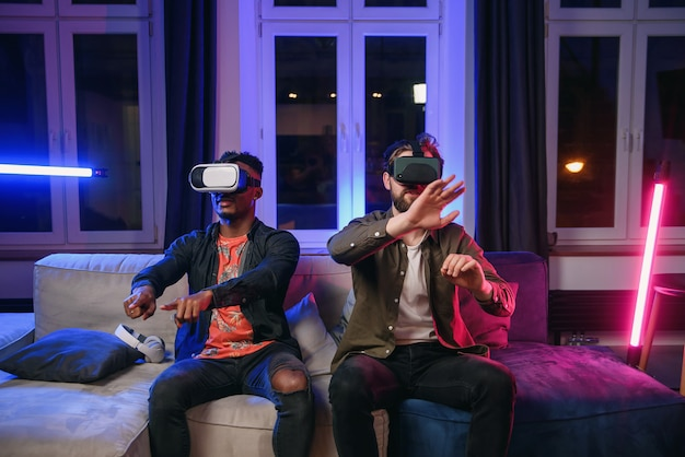 Two freelancers, developers having fun and working on new app for virtual reality goggles