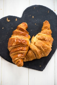 Two fresh croissants are ready for the breakfast