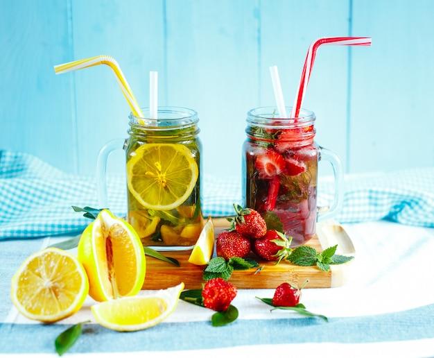 Two fresh glasses of lemon lemonade and strawberry