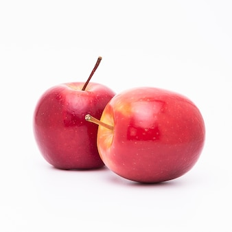 Two  fresh ripped red apples isolated on white background.