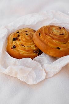 Two fresh rolls with raisins and banana cream