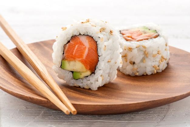 Two fresh salmon and avocado sushi uramaki