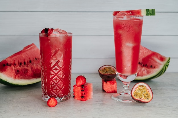 Two fresh watermelon cocktails on a wooden table