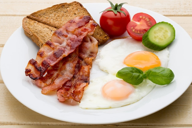 Two fried eggs and bacon for healthy breakfast