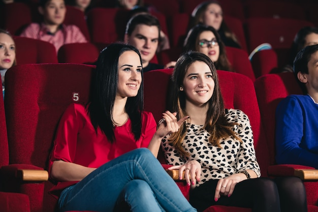 Two friends in the cinema on comedy