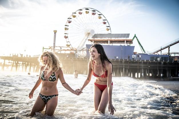 Two friends having fun in the ocean