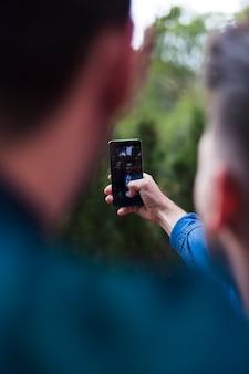 Two friends taking selfie on smartphone