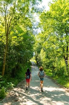 Two friends walking along the urdaibai path, a bizkaia biosphere reserve next to mundaka. basque country