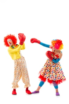 Two funny playful clowns, man and woman.