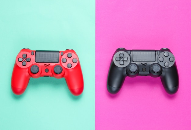 Two gamepad on a colored paper background. video game