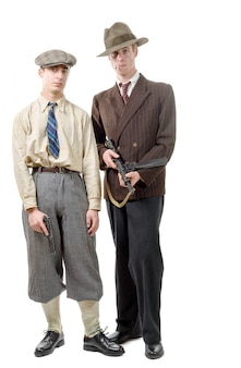 Two gangster in vintage clothing, with guns