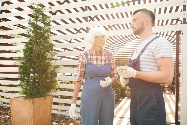 Two gardeners in sunlight