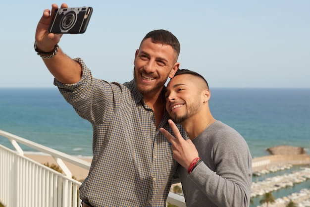 Two gay men in love having a good time