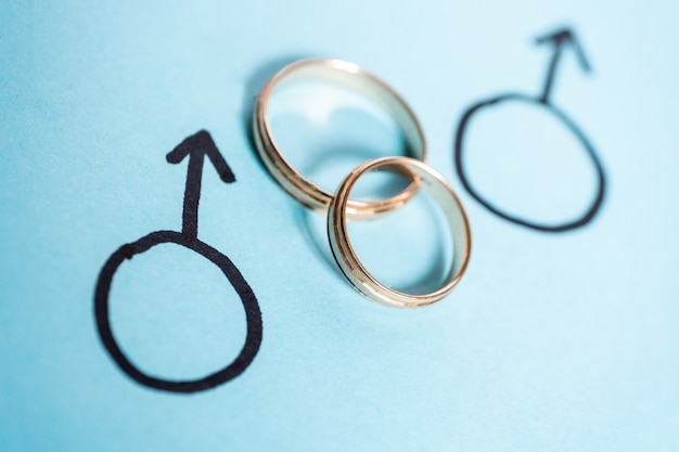 Two gender symbols of mars with wedding rings