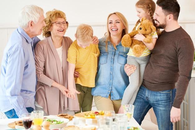 Two generation family posing