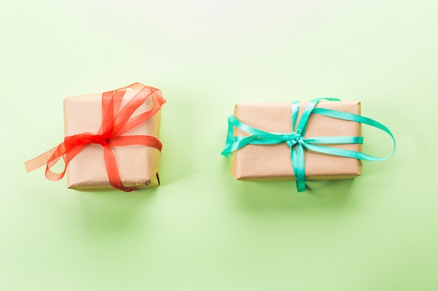 Two gift boxes on green pastel