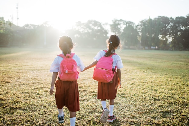 Two girl friend primary school student walking together