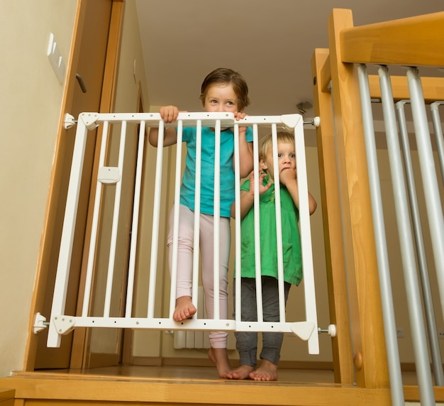 Two girls approaching safety gate