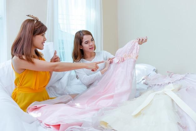 Two girls choosing dress
