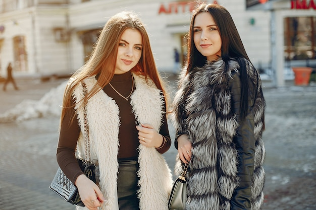Two girls in a city