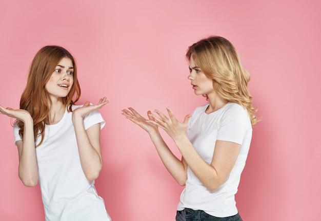 Two girls emotions studio communication lifestyle pink background
