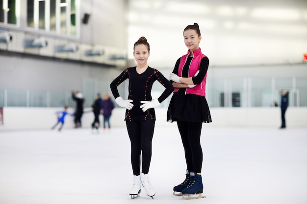 Two girls figure skating
