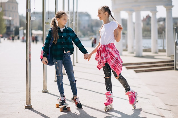 Two girls friends roller skating