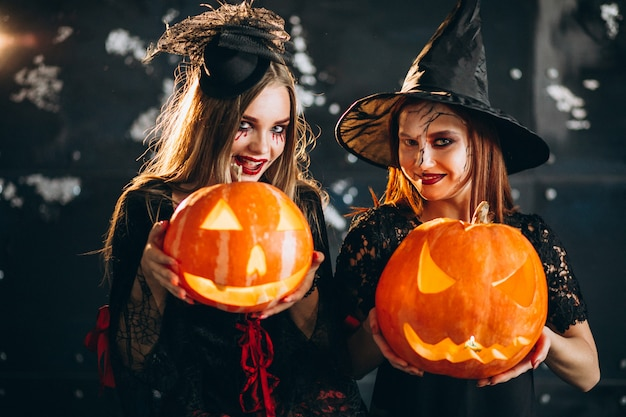 Two girls in halloween costumes
