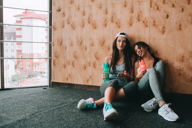 Two girls having a break at the gym