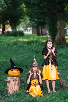 Two girls in witch costumes showing fear