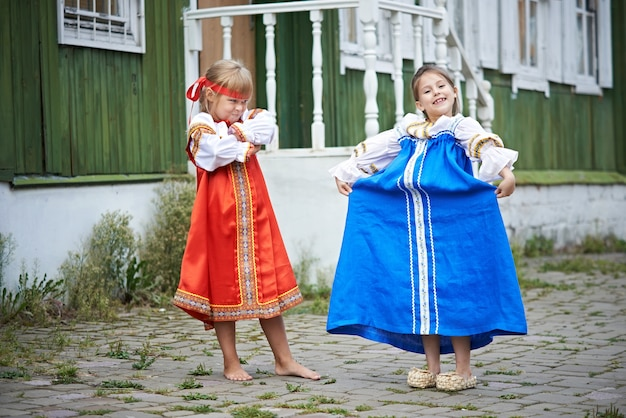 Two girls in national costumes in russian village
