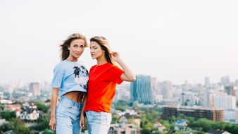 Two girls posing on rooftop