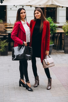 Two girls in red coats models