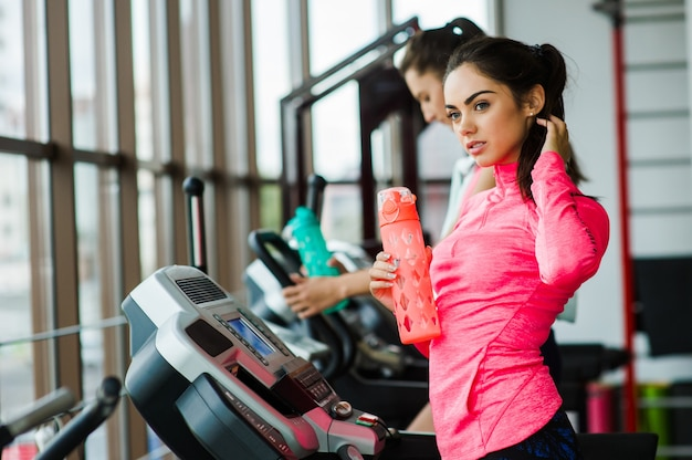 Two girls running on the treadmill