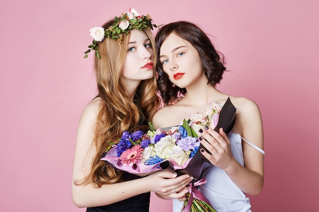 Two girls summer look beautiful clothes. flowers