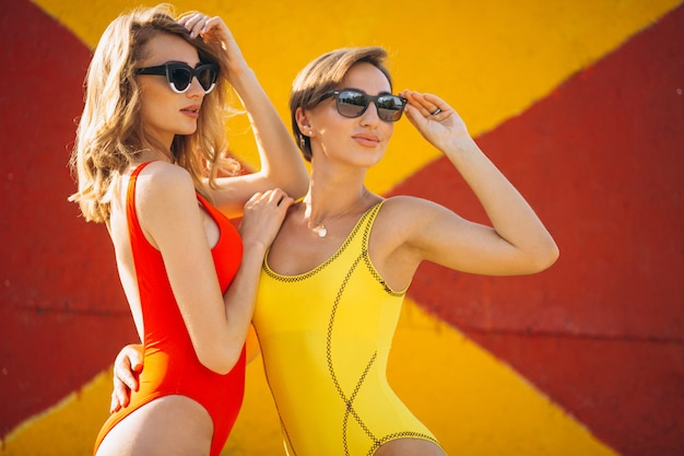 Two girls in swimmimg suit